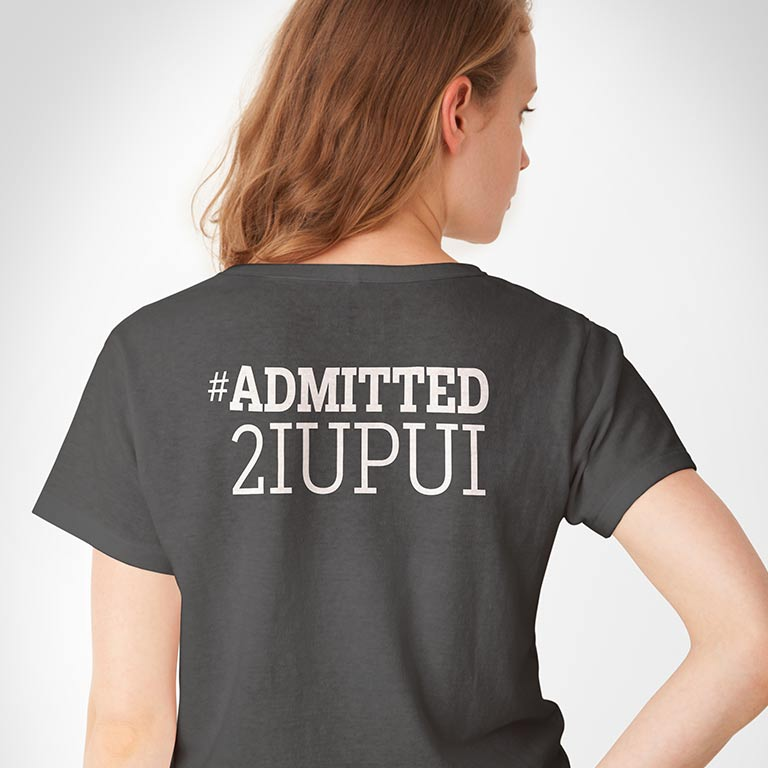 "Model wears a gray T-shirt that says, ""#Admitted2IUPUI"" on the back."