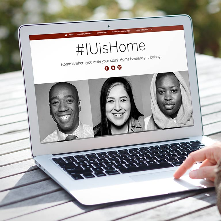 #IUisHome website displays on a laptop.